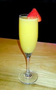 Cool and sweet, Carmen's Mimosa topped with fresh fruit