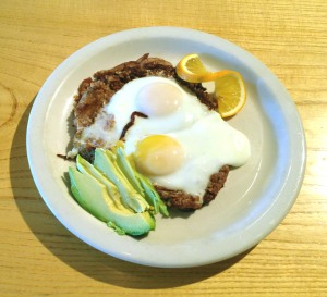 two eggs over kasha & caramelized onions, served w/ avocado